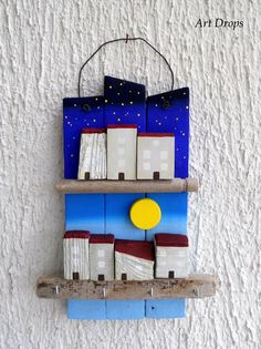 Cute Idea: Can do this to incorporate the stix 'n the stones using painted rocks instead of wooden homes & sun.