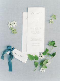 Photo by Romina Schischke. Charming garden wedding in Italy with stunning florals by Dario Benvenuti. Stationary with little flower details.