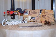 Rustic photo booth with props and book of wishes with Polaroid photo!