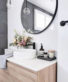 We love the dark charcoal tile against the classic white subway tiles. Modern finishes like the globe pendant and black fixtures keep this space interesting and fresh! . . . . . #dreambathroom #interiordesign #interiordecor #remodeling #renovate #interiorstyling #lovelydestinations #interiorinspo #designinspo #luxury #thatsdarling #marble #glamour #designtips #chicliving #portfolio #bathroom #homedecor #masterbath #interiorstyle #designblog #instastyle #lovelysquares #flashesofdelight…