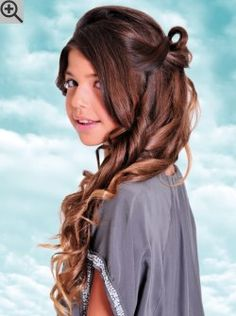 Festive hairstyle for teenage girls with long hair. The sleek lengths of the hair are curled.