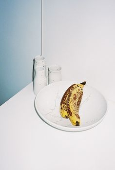 .WHITE PAINTING AND BANANAS.