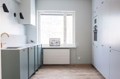 Watergreen base cabinets and feather grey high cabinets suit nicely together in this mid century modern kitchen. Mid Century Modern Kitchen, Base Cabinets, Helsinki, Scandinavian Design, Mid-century Modern, My Design, Ikea, Bathtub, Interior Design