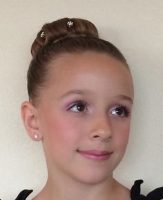 My daughter and her hair and makeup choice for her dance recital!!