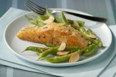 Salmon with Green Beans Amandine-This is a delicious recipe packed with flavor from Dijon mustard and garlic and fresh green beans Amandine on the side. It is an oven-broiled salmon recipe that is also a healthy Diabetic and a WeightWatchers (6) PointsPlus+ recipe. Makes 4 Servings.