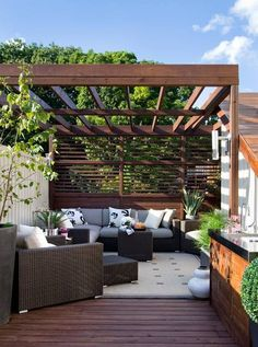 Bring your living space outdoors with couches, cushions and an open roof.