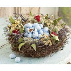 A Nest Full of Egg Candy and Colorful Flowers Make for a Great Centerpiece