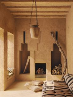 Sand and argil colors, with the shape of the windows, the fireplace and the side niches, plus the naturally texture of the wall painting, made this room an environment dominated by the earth element of feng shui. Interior Exterior, Interior Architecture, Adobe House, Natural Interior, Moroccan Design, Minimal Decor, Natural Building, Interior Styling, Interior Inspiration