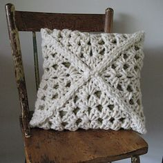 Simple granny square cushion...easier to buy colored pillow and stitch square over