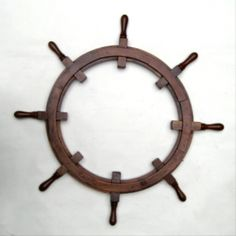 """36"""" Wood Ship Wheel Frame Only. 36"""" Diameter Ships Wheel with no center built.  This """"wheel"""" is specifically left middleless for your ship's wheel clock insert, picture frame insert, or plaque. Popular as Class Legacy gift forOfficer Development Schools. A full 36"""" across end of one peg to the other and 2 inches thick. Inside distance across from cutoff inside length is 18"""". Made from solid hardwood, brass fastenings, wood plugs, and a…"""