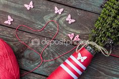 Sewing and knitting. Knitting on a wooden background. Buttons in the form of hearts and butterflies. Postcard love. Hobby. — Stock Photo © NataliaMilekhina #79051476