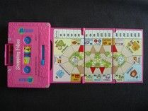 Flipsiders games.  Cassette cases that had a game board that popped out, magnetic pieces and the wheels of the cassette were the spinners to figure out your move.