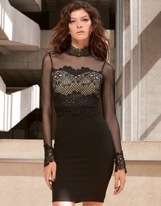 Be party ready in this bodycon dress by Lipsy. Featuring lace high neck and mesh sleeves, this little number really is the ultimate LBD. Add a pair of killer heels and statement earrings to complete the look.