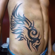 Rib Tattoos for Guys Tribal Wings, Rib Tattoos For Guys, Tribal Tattoos