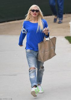 LA girl: Gwen Stefani looked casually cool as she ran errands in Los Angeles on Thursday, donning a long-sleeved bright blue sports jersey and artfully ripped jeans