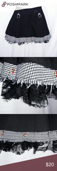 """Lip Service Goth Cherry Gingham Rockabilly Skirt Lip Service Goth Black Red Cherry Gingham Rockabilly Visual Kei Mini Skirt Size Small. This skirt is super cute! Full A-line shape. It has a zipper closure. It is lined with lace & gingham fabric with little red cherries embroidered on it. Each layer has that classic gothic fringed look. Excellent preowned condition with that worn in gothic faded black look.   Approximate measurements Waist: 28"""" Hip: 48"""" Length: 15"""" Lip Service Skirts Mini"""