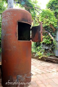 """The tardis"" - outdoor garden heater made from a recycled hot water cylinder"