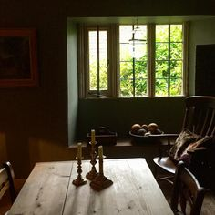 Early evening light after heavy rain #athome #diningroom #16thcenturyhouse #earlyeveninglight #countryfurniture #stonemullionwindow