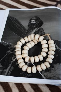 Add some neutral tribal chic to your wardrobe with this chunky white bone necklace on straw string. Fantastic African style! Also looks amazing in a bowl on the coffee table, too! Available at Maryam Montague's online Souk!  http://www.mmontague.com/fashion-inventory/white-bone-african-necklace