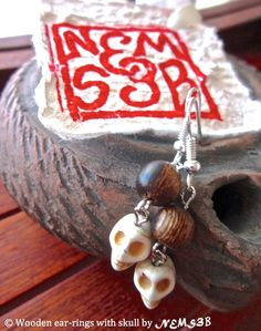 wooden ear-rings with white skull by NemSeb