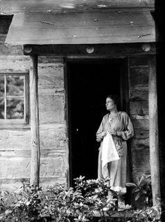 Clementine Douglass, spinner, in cabin door Asheville, NC 1920 - 1930?