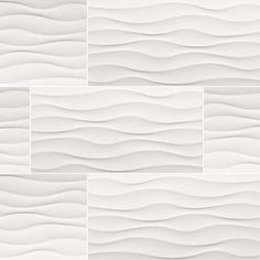 Dymo Wavy White large-format ceramic tile recommended for backsplashes, shower surrounds, and accent walls in both residential and commercial properties.