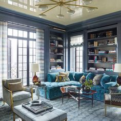 The library is outfitted with a custom-made sectional sofa covered in a Zoffany velvet; the 1950s cocktail table is Italian, as is the '60s chandelier from John Salibello, and the ceiling is painted in a high-gloss lacquer by Pratt Park Avenue Apartment, York Apartment, Transitional Chandeliers, Transitional House, Transitional Living Rooms, Transitional Lighting, Outdoor Furniture Sets, Home Furniture, Interior Exterior