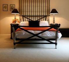 Majorelle Tranquilitie 100% wool blanket ideal for on the end of a bed. Orange and black working beautifully together. www.tranquilitie.com