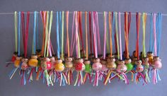 Tiny dolls on strings, look great as a collection. I'm not sure exactly what these are, google translate calls them 'chips' ? Anyone know?