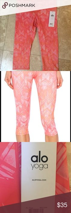 NWT - ALO YOGA medium crops Adorable orange print capris. My pics better represent true color. NWT. Only selling cause not a fan of Capri leggings. ALO Yoga Pants Capris