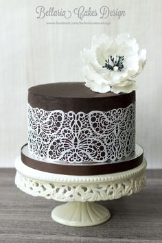 Usually I cover a cake with fondant after I've ganached the cake. This time, for a friend of mine who doesn't like fondant, I've used pure chocolate ganache only and edible lace. This cake is a chocolate cake filled with mocca cream and chocolate mousse. Gorgeous Cakes, Pretty Cakes, Amazing Cakes, Fondant Cake Designs, Fondant Cakes, Cupcakes, Cupcake Cakes, Edible Lace, Ganache Cake