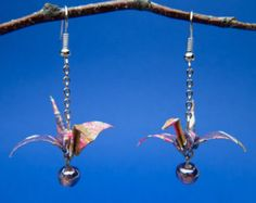 Items similar to Origami Crane earrings; resin-coated washi paper, dangle drop, purple on Etsy Resin Coating, How To Make Earrings, Washi, Crane, Origami, Glass Beads, Unique Gifts, Dangles, Purple
