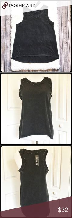 Isy & Ki Edgy Black Tank Gorgeous black tank with black threading and brass colored grommets adorning the neckline.  Truly a cute top. Measurements laid flat: bust arm pit to arm pit 18 in, front of shirt hem from top of shoulder to hem is 23 1/2 in, back of top from top of shoulder to hem is 26 1/2 in. Isy & Ki Tops Tank Tops
