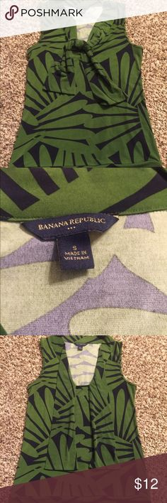Tropical sleeveless blouse Fun yet professional tropical print in navy and green. Perfect under a blazer for work, or with shorts for the weekend. Tie it however you like for your own style! Banana Republic Tops