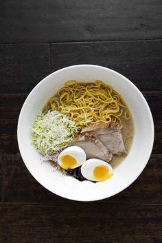 Pork Shoulder: Slow roasted & pressed, ramen style smoky pork broth, local egg noodle, soy pickled mushrooms, nappa, carrot, cilantro, radish, onsen egg