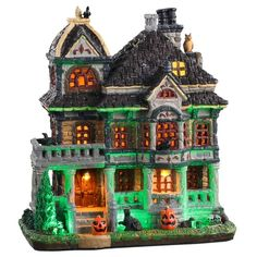 Exterior lighting on building casts an eerie glow. Halloween Village Display, Halloween Town, Village Lemax, Cider House, Spooky Places, Light Building, Creepy Clown, Haunted Mansion, Exterior Lighting