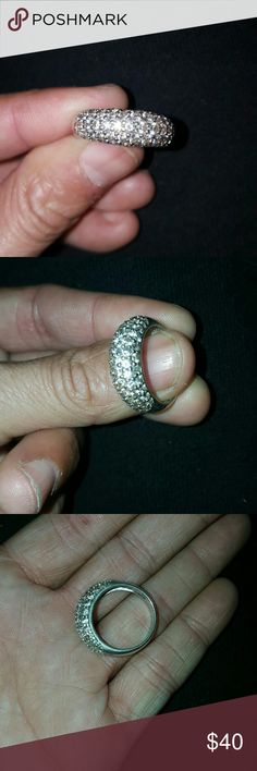 Sterling silver Diamond accent ring Ring displays 925 inside the ring. I do not have a ring sizer however it is too big for me. I believe and was told it is a size 7.  I wear a size 5/6 and its a little big for my ring and middle finger but fits my pointer. I hate to sell it but jewelry just isnt for me. The ring is very beautiful and isnt cheaply made nor look guldy in person. This one would be something that i could see myself wearing out but again, its slightly to big for me. Happy…