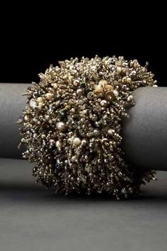 Grey Glamour Couture Cuff – ANDREA GUTIERREZ JEWELRY. Pearls, sterling silver, moonstones, vintage cut crystals, vintage seed beeds, and Swarovski crystals hand embroidered on heavy silk with a hammered silver clasp. $3,000