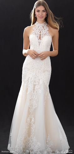 This lace gown features a high illusion neckline and back.
