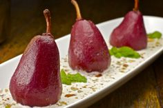 Poached Pears in Amaretto Crème Wine-poached pears bathed in sweet amaretto cream sauce with chopped almonds. Cajun Recipes, Tea Recipes, Fruit Recipes, Wine Poached Pears, Sweet Red Wines, Dessert Sauces, Desserts, Creole Cooking, Red Pear