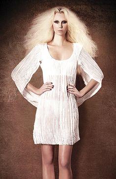 Lacy hood dress by Tiia Vanhatapio