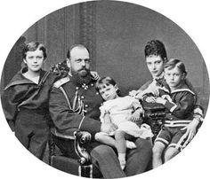 Tsar Alexander lll of Russia and Empress Marie Feodorovna of Russia with their first three children,Tsarevich Nikolai Alexandrovich Romanova of Russia,Grand Duke George Alexandrovich Romanova of Russia and the Grand Duchess Xenia Alexandrovna Romanova of Russia.