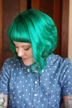 This is Punky Colour Turquoise mixed with equal parts Punky Colour Bright Yellow and conditioner on the top layers of hair with Punky Colour Apple Green underneath.