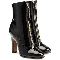High-shine patent leather, carbon black color and a flash of gold-tone hardware make these Valentino ankle boots a firm favorite for your new-season repertoire…