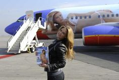 Here, Israeli model Bar Refaeli holds the cover of the 2009 Sports Illustrated swimsuit issue as she unveils SI One, a Southwest Airlines Bo...