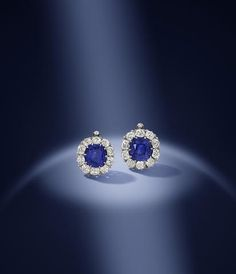 A magnificent pair of late 19th century sapphire and diamond earrings. Each set to the centre with a cushion-shaped sapphire, one weighing 7.96 carats, the other weighing 7.92 carats, within a border of old brilliant-cut diamonds, converted, diamonds