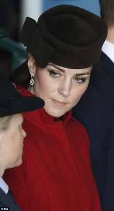 Looking her usual stylish self, 34-year-old Kate paired the elegant outerwear, called 'Ami...