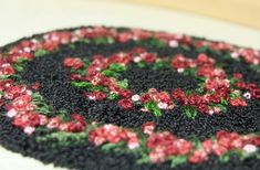 Dollhouse rug made using french knots.  Love this!