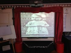 Movie theater classroom theme!   The stage is made from a trapezoid table with the adjustable legs taken off.