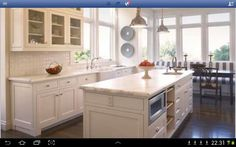 My dream kitchen.  I think the granite is Bianco Romano.  The creme subway tile backsplash is perfect compliment.